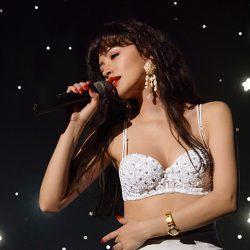 Screenshot of Selena singing on stage