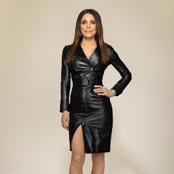 Bethenny striking a pose in black leather dress