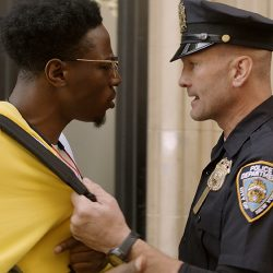 Screenshot from Two Distant Strangers of police officer confronting black man