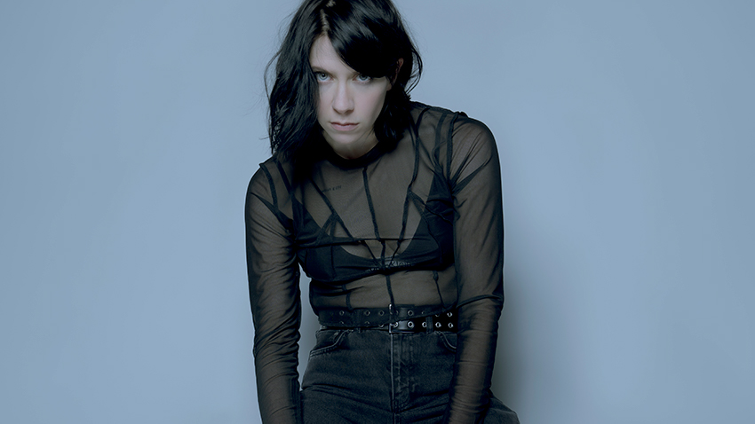 K.Flay posing hunched over