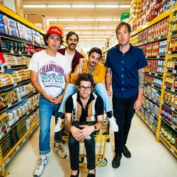 The Arkells posing in No Frills grocery store