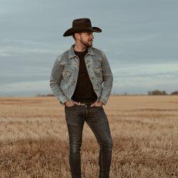 Brett Kissel posing in field