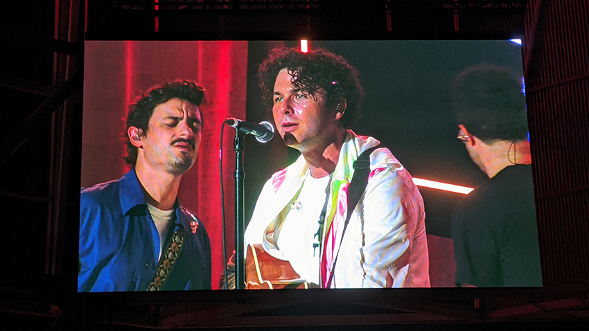 Photo of the jumbotron of Arkells performing on the Budweiser stage.