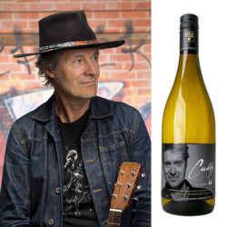 Jim Cuddy and a bottle of his Tawse Chardonnay wine.
